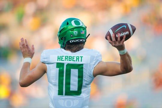 Nov 23, 2019; Tempe, AZ, USA; Oregon Ducks quarterback Justin Herbert warms up prior to the game against the Arizona State Sun Devils at Sun Devil Stadium. Mandatory Credit: Mark J. Rebilas-USA TODAY Sports
