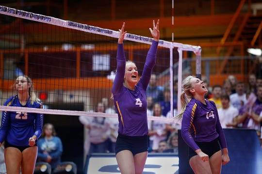 Watertown's Sophie Tietz (4) and Alexx Bayles celebrate a point vs. O'Gorman at the 2019 South Dakota State Volleyball Championships at the Rushmore Plaza Civic Center in Rapid City, S.D.