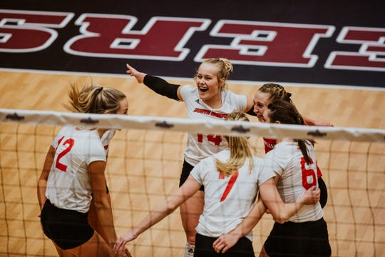 South Dakota volleyball team celebrates a point during its Summit League semifinal match against Omaha.