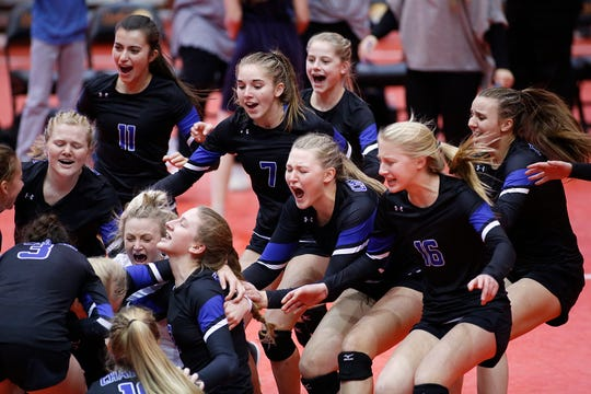 November 22, 2019; Rapid City, SD, USA; Players rush their teammates  as Sioux Falls Christian defeats Dakota Valley for the A championship at the 2019 South Dakota State Volleyball Championships at the Rushmore Plaza Civic Center in Rapid City, S.D.
