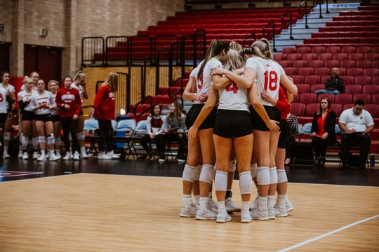 South Dakota volleyball team huddles during its Summit League semifinal match against Omaha.