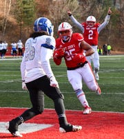 Kai Barber crosses the goal line for a St. John's touchdown during the second half of the Saturday, Nov. 23, 2019, game against Aurora University at Clemens Stadium in Collegeville.