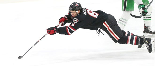 St. Cloud State's Luke Jaycox stretches for the puck  in Saturday's NCHC game at the Ralph Engelstad Arena in Grand Forks.
