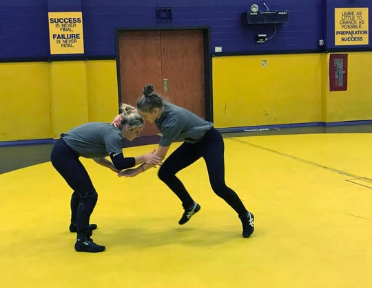 Abby Nelson, right, wrestles her teammate Brooke Thurber during an Oct. 22, 2019, practice of the women's wrestling squad at the University of Wisconsin-Stevens Point, Wis. The program is new this year.