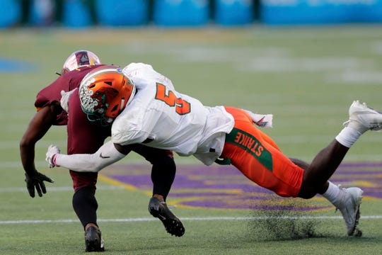 FAMU defensive back Markquese Bell (5) dives to tackle a player. The Rattlers lost to the Bethune-Cookman Wildcats 31-27 in the Florida Classic on Saturday, Nov. 23, 2019.