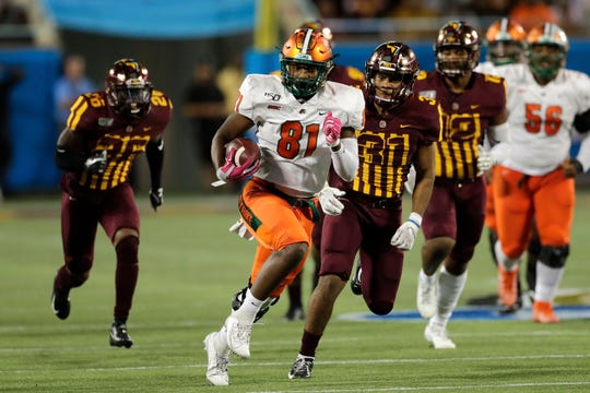 Florida A&M tight end Kamari Young (81) runs for a first down vs. Bethune-Cookman in the Florida Blue Florida Classic at Camping World Stadium in Orlando on Saturday, Nov. 23, 2019.
