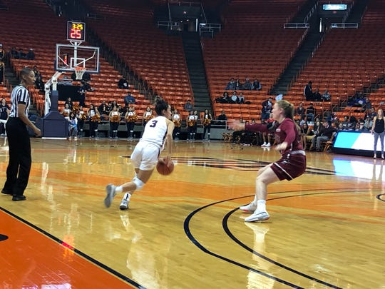 UTEP's Katia Gallegos drives against the defense of New Mexico State's Amanda Soderqvist Saturday night at the Don Haskins Center