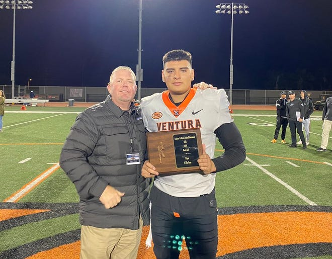 Ventura College tight end Daniel Moraga poses with realtor Mike Kapp after being name team MVP of the Joe Kapp Real Estate Beach Bowl on Saturday night.