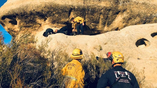 Rescuers work Friday to get an 11-year-old out of a crevice  along the Piedra Blanca trail in the area of Rose Valley north of Ojai. Due to rapidly cooling temperatures, the distance of the hike out and the time the youth was trapped, rescuers decided to fly the patient out.