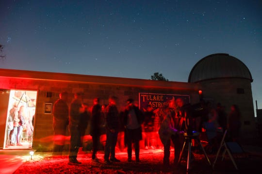 Star party attendees line up to look in the telescope at the Arthur Pursell Observatory on Saturday, Nov. 23.