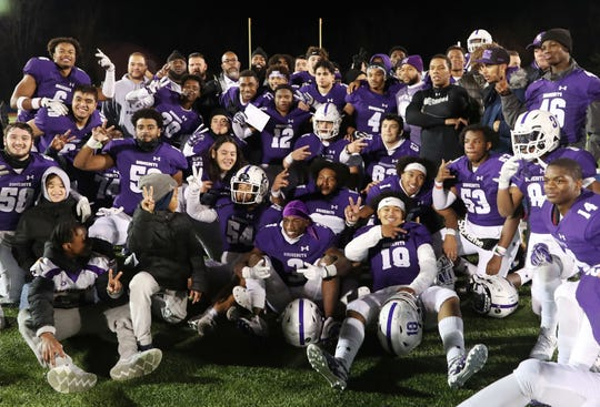 New Rochelle players celebrate their 24-17 victory over Shenendehowa in the NYSPHSAA Class AA state semifinal at Middletown High School Nov. 23, 2019.