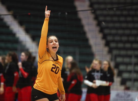 Valhalla's Isabella Masucci (20) signals one more point during their 3-1 win over Portville in the NYSPHSAA Class C volleyball championship match at the Cool Insuring Arena in Glens Falls on Sunday, November 24, 2019.