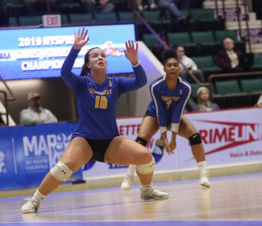 Irondequoit's Emma Sheehan (10) defends a block in the NYSPHSAA Class A volleyball championship match against Burnt Hills at Cool Insuring Arena in Glens Falls on Sunday, November 24, 2019.