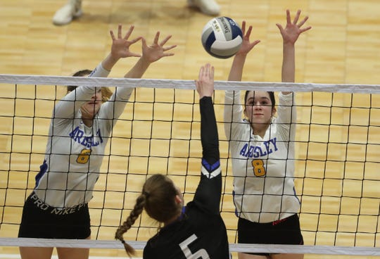 Ardsley's Megan Bruno (6) and Madison Gordon (8) set up a block during their 3-0 loss to Westhill in the NYSPHSAA Class B championship volleyball match at the Cool Insuring Arena in Glens Falls on Sunday, November 24, 2019.