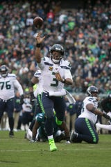 Seattle's Russell Wilson (3) throws towards the end zone Sunday against the Eagles. The Seahawks defeated the Eagles 17-9.