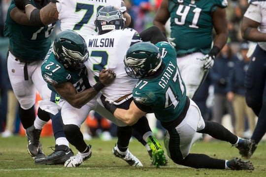 Eagles' Malcolm Jenkins (27) and Nathan Gerry (47) sack Seattle's Russell Wilson (3) Sunday at Lincoln Financial Field. The Seahawks defeated the Eagles 17-9.