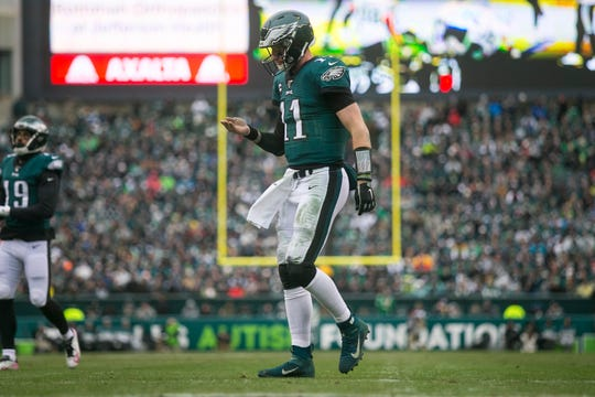 Eagles' Carson Wentz (11) looks down at his throwing hand during the third quarter against the Seahawks Sunday at Lincoln Financial Field. The Seahawks defeated the Eagles 17-9.