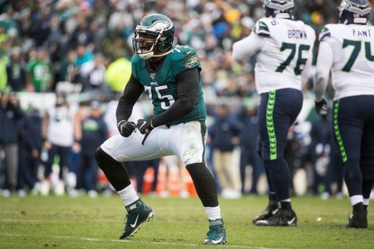 Eagles' Vinny Curry (75) celebrates a defense stop against the Seahawks.