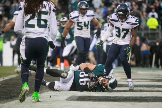 Eagles' Zach Ertz (86) clutches the ball in the end zone to score in the fourth quarter Sunday against the Seahawks. The Seahawks defeated the Eagles 17-9.