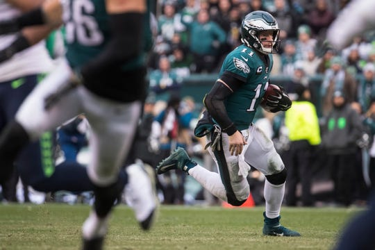 Eagles' Carson Wentz (11) scrambles for yardage Sunday against the Seahawks. The Seahawks defeated the Eagles 17-9.