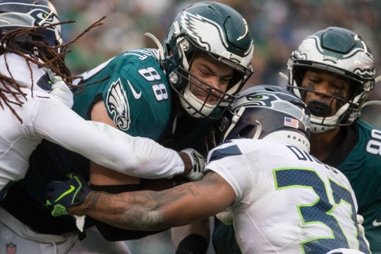 Eagles' Dallas Goedert (88) struggles to get through the Seattle defense Sunday at Lincoln Financial Field. The Seahawks defeated the Eagles 17-9.