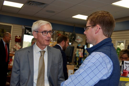 Steve Bechel, left, Vice President of Operations for Eau Galle Cheese Factory tells Gov. Tony Evers that with reasonable regulation and targeted investments in the dairy industry, the state can help cheese processors overcome the challenges of dynamic changes in international trade and a widespread workforce shortfall.
