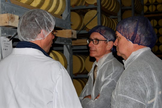 Steve Bechel, left, Vice President of Operations for Eau Galle Cheese Factory and WCMA First Vice President, discusses the operation of the Eau Galle Cheese Factory with State Sen. Jeff Smith, right, and Gov. Tony Evers.  The plant is a family-owned business that opened in 1945, makes award-winning Italian-style cheeses.