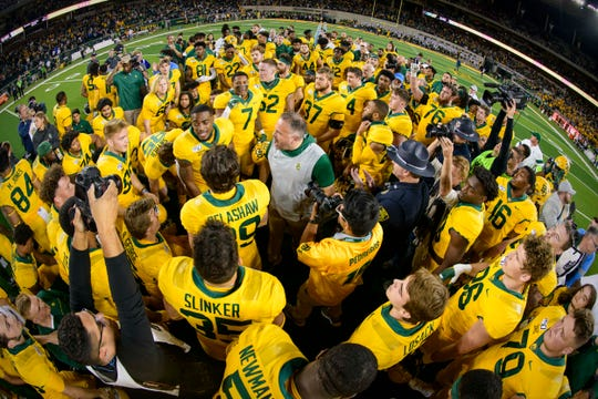 Baylor head coach Matt Rhule (center) fires up his team after a win against Texas.