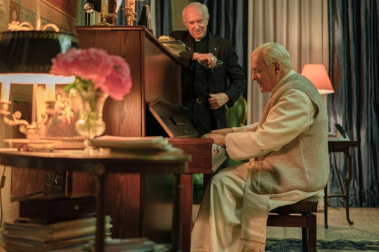 "Pope Benedict (Anthony Hopkins, right) shows a hidden musical side to Cardinal Bergoglio (Jonathan Pryce) in ""The Two Popes."""