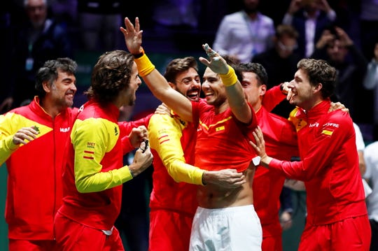 Spain's Davis Cup team celebrates with Rafael Nadal, center, after Nadal's win over Canada's Denis Shapovalov clinched the nation's sixth Davis Cup tile.