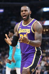 Lakers forward LeBron James reacts after a play against the Memphis Grizzlies during the second quarter at FedExForum.