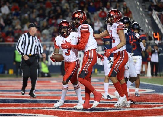 Utah wide receiver Demari Simpkins (3) celebrates a touchdown with teammates during the first half against Arizona at Arizona Stadium.