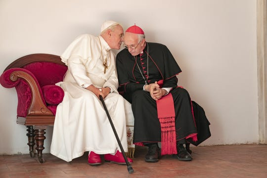 """Pope Benedict (Anthony Hopkins, left) meets with Cardinal Jorge Bergoglio (Jonathan Pryce) in the Netflix dramedy """"The Two Popes."""""""