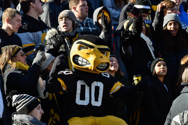 Herky the Hawk reacts with fans during the third quarter of the Iowa Hawkeyes' game against the Illinois Fighting Illini at Kinnick Stadium.