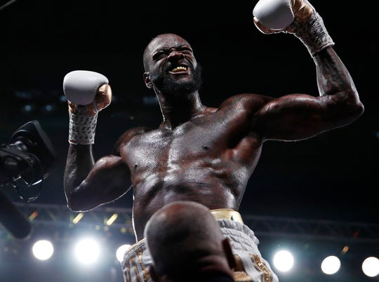 Deontay Wilder celebrates after knocking out Luis Ortiz.