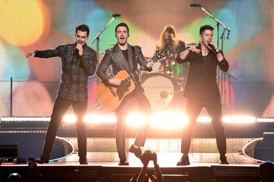 Joe Jonas, Kevin Jonas, and Nick Jonas of The Jonas Brothers perform at Barclays Center on Nov. 23, 2019 in New York City.