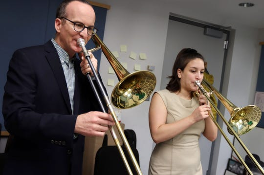 Tim Albright, assistant professor of music in the Lawrence University Conservatory of Music, left, works with junior Allie Goldman during a recent trombone teaching session in Shattuck Hall.