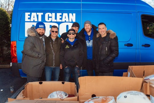 Celebrities distribute turkeys at Lunch Break in Red Bank on Nov. 23, 2019.