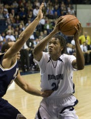 Monmouth's Travis Taylor works against a Florida International defender during the first game at OceanFirst Bank Center on Nov. 13, 2009.