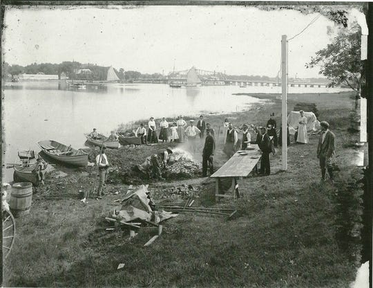 An early 1900s photograph of a clam bake on the riverbank adjacent to where the the Port Au Peck hotel once stood. It burned in 1923. It was located in the center of what is now Wardell Circle.