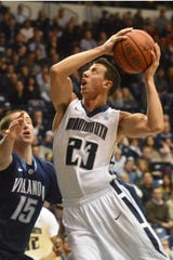 Monmouth's Stephen Spinella (23) goes up for a shot against Villanova's Ryan Arcidiacono in the first half Saturday at the Multipurpose Activity Center.