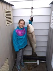 Bebe Spinoso of Toms River with a 25-pound striped bass on the scale at Brielle Bait & Tackle on Nov. 23, 2019.