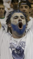 Fan in the Monmouth student section during the first-ever game at OceanFirst Bank Center on Nov. 13, 2009.