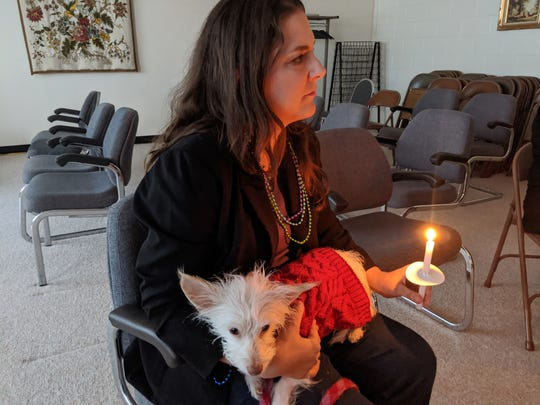 Samantha Manski and Ollie listen to the stories of survivors of suicide loss during a candlelight vigil Nov. 23. Manski, executive director of Mental Health America of Abilene, has been an adamant supporter of the Community Foundation of Abilene's learning programs both through the foundation and a group of executive directors started by CFA President Katie Alford.