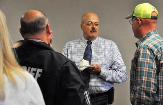 Lt. John Cummins, center, is retiring after 34-plus years with the Taylor County Sheriff's Office. Dozens of friends and colleagues attended a party in his honor Monday at the Taylor County Sheriff's Office.