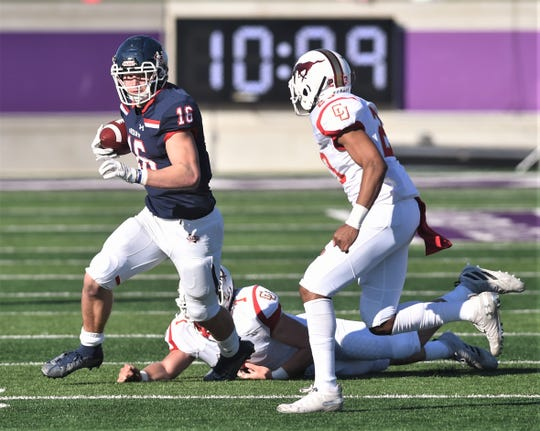 Denton Ryan's Drew Sanders looks for running room against Lubbock Coronado. Sanders, who is committed to Alabama, plays both offense and defense for the Raiders. Ryan beat Coronado 56-14 in the Region I-5A Division I area playoff game Saturday at ACU's Wildcat Stadium.