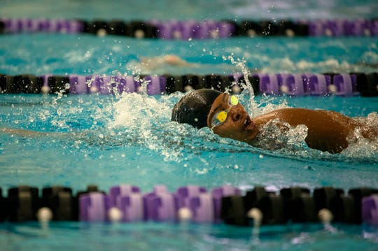 Battle Creek Central swimmer January Johnson competes in the 400 yard freestyle relay on Saturday, Aug. 24, 2019 at Lakeview High School.