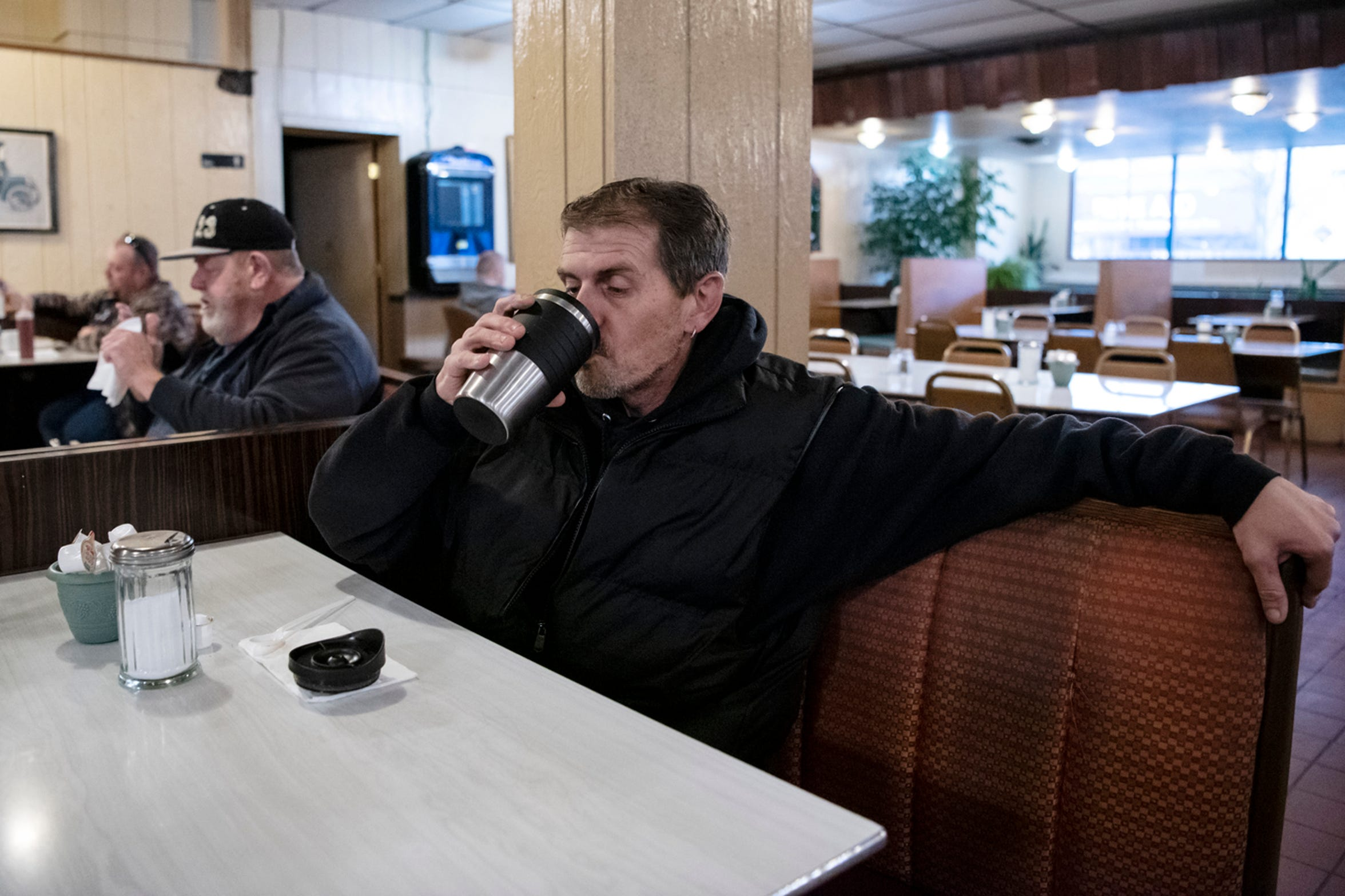 William Crapo from Battle Creek drinks coffee on Wednesday, Nov. 20, 2019 at Speed's Koffee Shop in Battle Creek, Mich. Crapo has been coming to Speed's for 30 years.