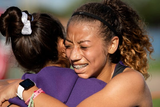 Lakeview students Fresia Hernandez-Velasco and Karria Watkins embrace after running in the Battle Creek All City Invitational on Monday, Sept. 23, 2019 at Harper Creek High School in Battle Creek, Mich.