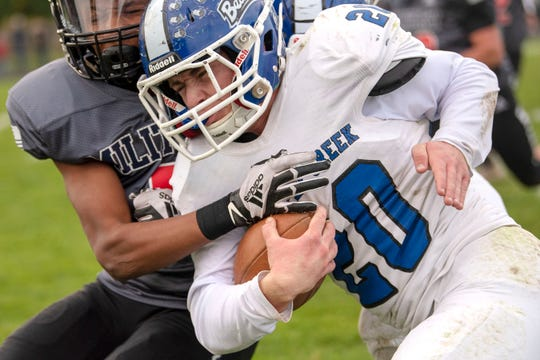 Lakeview junior Jaden Simonson (8) tackles Harper Creek senior Drew Mitchell (20) on Friday, Oct. 25, 2019 at Lakeview High School in Battle Creek, Mich.